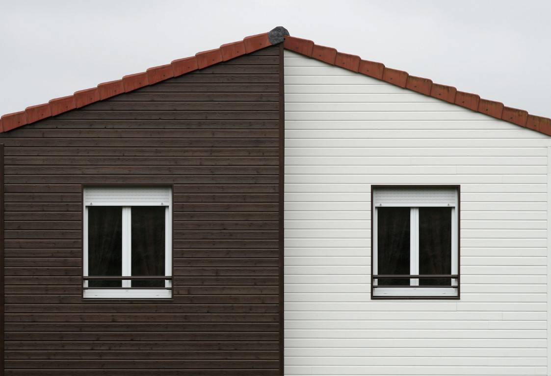 european house with contrasting panels and double glazing windows