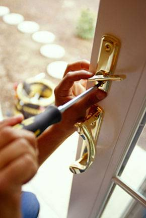 door handles and locks being installed with screwdriver