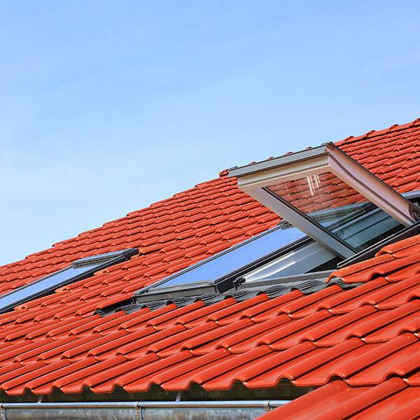 building roof red tiles with double glazed velux windows
