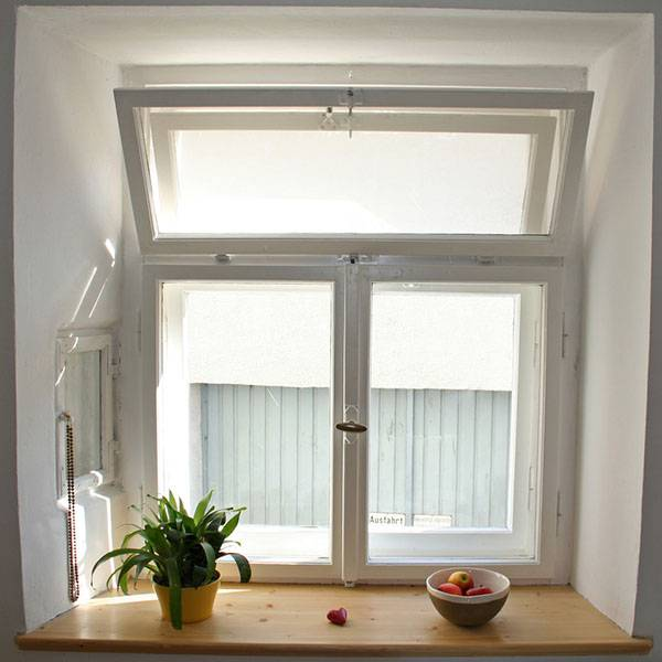 loft room white glazed windows with plant and fruit bowl