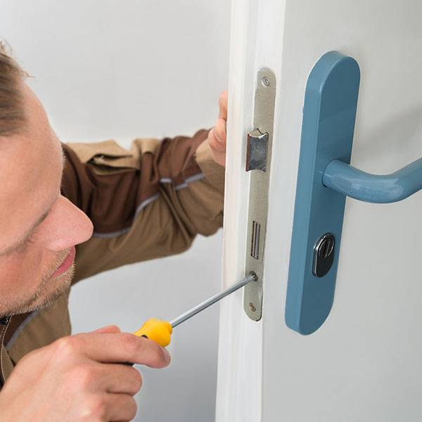 door repair installing lock with screwdriver