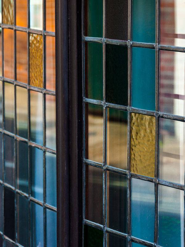 mixture of traditional window panels with yellow stained glass backing panels