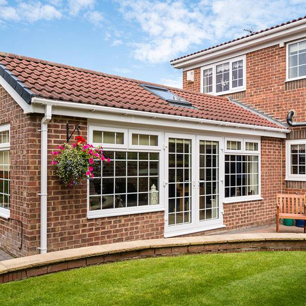 large red brick orangerie home extension with upvc windows and upvc doors