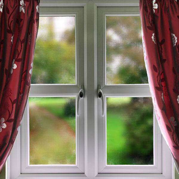 upvc windows with red floral curtains