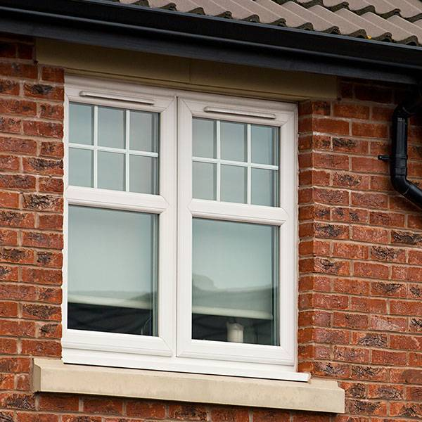 red brick house wall with double glazed windows