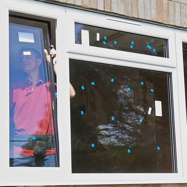 glazier installing double glazing windows