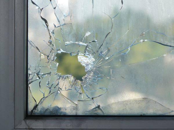broken window corner unit cracked smashed glass