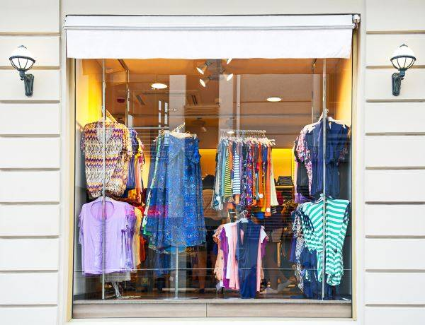 shopfront glass panel with clothes on display